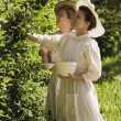 Stock Photo: Women Picking Berries In Old-Fashioned Clothing