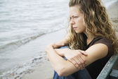 A Young Adult Woman Reflects On The Beach — Stock Photo
