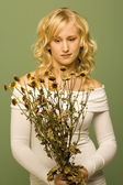 Lady Looking At Wilted Flowers — Stock Photo