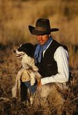 Cowboy With His Dog — Stock Photo
