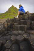 Giant's Causeway, County Antrim, Ireland, Man Sitting On Basalt Columns — Stock Photo