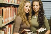 Twin Students In A Library — Stock Photo