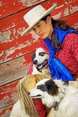 Cowgirl With Two Dogs — Stock Photo