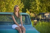 Young Woman Sitting On Hood Of Old Truck — Stock fotografie