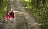 Two Girls Walking Down Road — Stock Photo