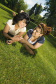 Girls Laughing In Grass — Stock Photo