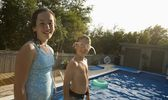 Girl And Boy Smiling By Swimming Pool — Stock Photo