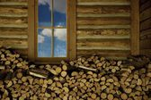 Woodpile Inside Log Building — Stock Photo