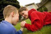 Children Arm Wrestling — Stock Photo