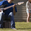 Stock Photo: Teen Playing Guitar
