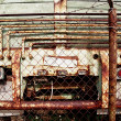 Stock Photo: Old Rusty Truck Behind Fence