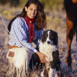 Cowgirl With Her Dog — Stock Photo #31721157