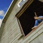 Boy Playing Guitar In Barn Window — Stock Photo
