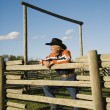 Stock Photo: Rancher Leaning On Corral