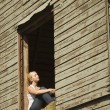 WomSitting In Barn Loft — Stock Photo #31721339