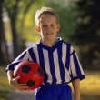 Stock Photo: Boy Carrying Soccer Ball