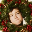 Stock Photo: Young Boy In Christmas Wreath