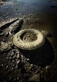 Old Tire Abandoned On Beach — Stock Photo