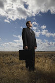 Business Man In A Field — Stock Photo
