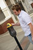 Man Plugging A Parking Meter — Stock Photo
