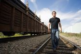 Man Walking On Railroad Tracks — Stock Photo