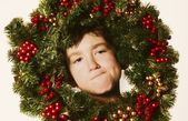 Young Boy In Christmas Wreath — Stock Photo