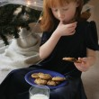 Girl Eating Milk And Cookies — Stock Photo