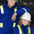 Stock Photo: TradesmAnd Junior Tradeswoman