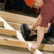 Content Carpenter Working With Power Tool — Stock Photo #31755299