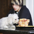 Teenager Listening To Music While His Dog Is On The Counter Eating Sandwiches — Stock Photo #31755633