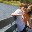 Teenagers Sitting On A Bench By Water — Stock Photo