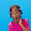 African Little Girl With Butterfly Barrettes And A Butterfly On Her Nose Looking Surprised — Stock Photo #31757857