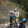 Father And Sons On River Shoreline — Stock Photo