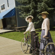 Two Women With Vintage Bicycle Built For Two — Stock Photo #31758917