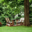 Wooden Chairs Set Up In A Yard — Stock Photo