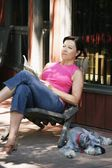 Woman Relaxing With Book On The Deck — Stok fotoğraf