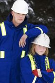 Tradesman And Junior Tradeswoman — Stock Photo