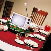 Tv On Platter On Dinner Table — Stock Photo