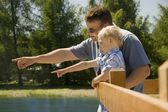 Father And Son At Water's Edge — Stock Photo
