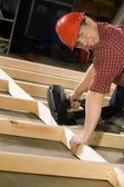 Content Carpenter Working With Power Tool — Fotografia Stock