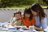 A Mother Reading To Her Children — Stock Photo