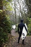 Surfer In Steamer Wetsuit, Carrying Board To The Beach — Stock Photo