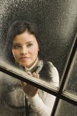 Woman Looking Out The Window — Stock Photo