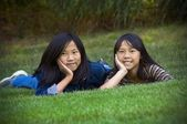 Two Sisters Lying In The Grass — Stock Photo