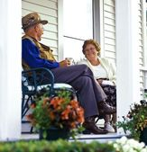 An Elderly Couple Sitting On A Porch — Stock Photo