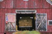 American Flag Hanging From A Barn Door — Stock Photo