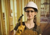 A Woman Wearing Construction Hat And Holding A Hammer — Stock fotografie