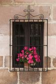 Window With Flowers And Cross, Carmona, Cantabria, Northern Spain — Stock Photo