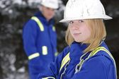 Tradeswoman With Tradesman Out Of Focus — Stock Photo
