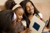Girls Reading And Laughing Together — Stock Photo
